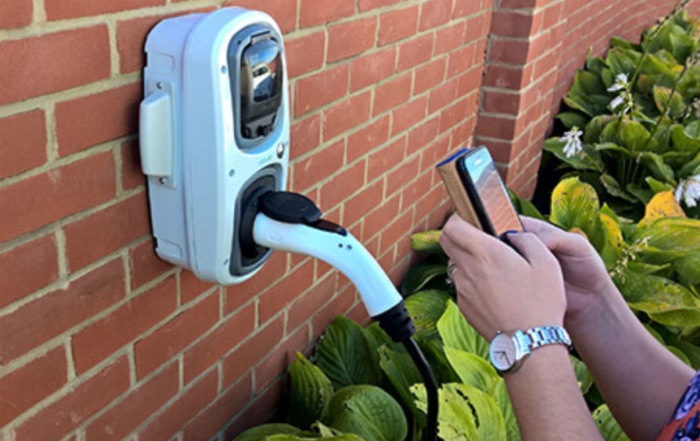 RolecEV Smart Chargepoint being used by man with a mobile phone
